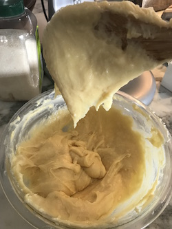 """The batter makes a """"V"""" shape when falling off the spatula"""